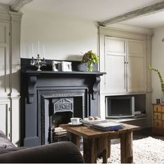 Rustic painted alcoves- Cupboards are essential to keep living room clutter under control!