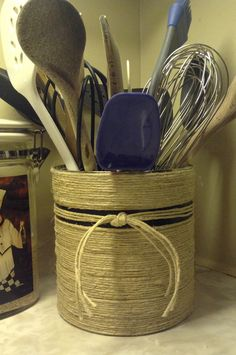 DIY coffee can utensil holder.  Twine, glue gun and one line of electrical tape.