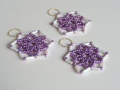 Three piece set of seed bead stars in white by Kreativprodukte