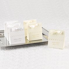"""Ivory Scalloped Favor Boxes Item Number ZBK1756 Ivory favor boxes with pearl-embossed designs and scalloped front edges. Ivory 3 /8"""" pre-cut, satin ribbon included."""