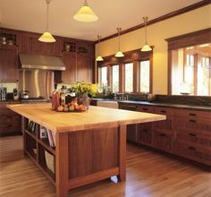 craftsman kitchen cabinets | Craftsman Kitchen. Yellow walls, hanging lights, lots of medium toned ...