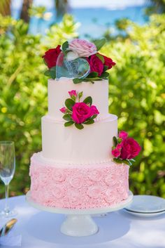 Andaz Maui at Wailea Resort Wedding Cakes  3 Tier Pink Buttercream with a floral textured bottom tier and bright fuchsia flowers. Beautiful setting in Wailea, Maui, Hawaii.