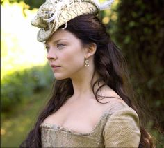 """Natalie Dormer as Anne Boleyn in 'The Tudors'. """"She was never described as a great beauty, but even those who loathed her admitted that she had a dramatic allure. Her dark complexion and black hair gave her an exotic aura in a culture that saw milk-white paleness as essential to beauty. Her eyes were especially striking: 'black and beautiful' wrote one contemporary, while another averred they were 'always most attractive', and that she 'well knew how to use them with effect'."""
