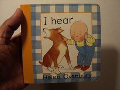 I Hear by Helen Oxenbury. In boardbook format. Used and in very good condition. From Candlewick Press. Released in 1995. Made in China. Clean. Without notes & highlighting in all its pages. Readable.