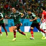 Rafael Marquez (2nd L) of Mexico celebrates scoring