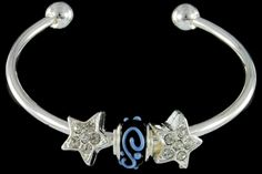 silver plated items: bangle, two star beads with cubic zirconia. One glass bead with 925 silver core.