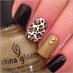 Gold nails,black nails,black and gold nails,animal print nails