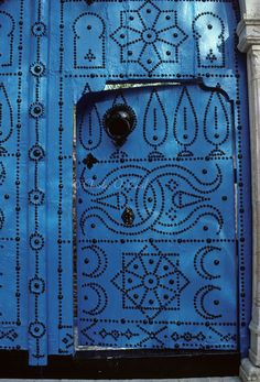 Africa | Tunisia, Sidi Bou Said. Small Blue Door inside Larger Door. | ©Charles O Cecil