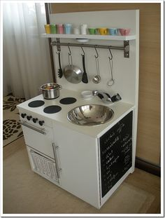 This is neat and reminds me of Heather's kitchen in Munich - refrigerator under the sink and cupboards above.