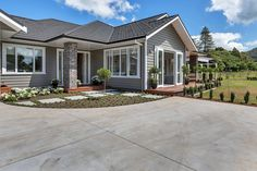 Karapiro weatherboard house by Landmark Homes with separate lounge, indoor-outdoor flow is great for rural and urban sites Traditional Home Exteriors, Traditional House, Weatherboard House, Latest House Designs, Exterior Cladding, Open Plan Living, House Goals, Luxury Homes, Indoor Outdoor