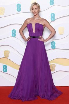 At the BAFTAs 2020 Charlize Theron wore her boldest Dior dress yet. Vogue speaks to Charlize Theron's stylist, Leslie Fremar, to get all the details on her BAFTAs 2020 dress. Charlize Theron, Kate Middleton, Magenta, Bright Purple, Alexander Mcqueen, The Baftas, Purple Gowns, Purple Dress, Dior Dress