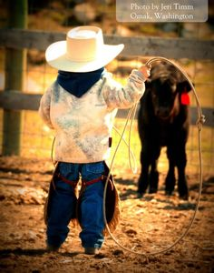 little cowboy and calf This Little Cowboy is working his way to competing in a Mormon Pioneer National Heritage Area rodeo! Cowboy Baby, Little Cowgirl, Cowgirl And Horse, Cowboy Up, Cowboy And Cowgirl, Cute Kids, Cute Babies, Westerns, Farm Kids