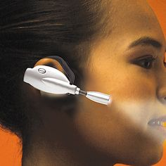 The Hands Free Over Ear Book Light - Hammacher Schlemmer - Focused beam shines only in the direction you're looking.