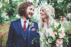 Kirsty wears a Rue de Seine wedding dress and veil by Minna, for her 1970s, bohemian inspired London Pub wedding.  Photography by Philippa James.
