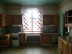 """Masonite walls in a kitchen in a house builded 1892. Probably they made this in the 30s / 40s. Masonite was used for many applications including doors, roofing, walls at that time when beaded boards become unpopular. The sealing has a """"nice"""" turquoise color."""