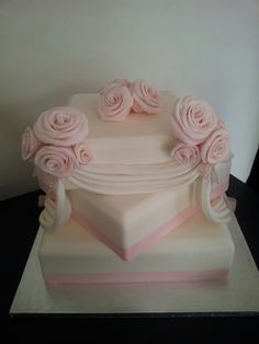 Pink and white wedding cake with gardenia intead of rose