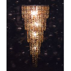 Stuart Haygarth's Spectacle Chandelier, made from 1,020 pairs of prescription glasses.