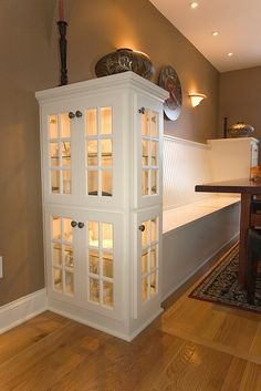 Love this....built in dining bench with cabinet ends