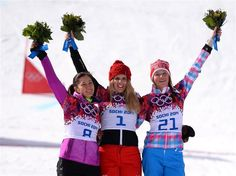 (L-R) Silver medalist Tomoka Takeuchi of Japan, gold medalist Patrizia Kummer of Switzerland and bronze medalist Alena Zavarzina of Russia celebrate on the podium during the flower ceremony for the Snowboard Ladies' Parallel Giant Slalom Finals