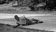 26-year-old Associated Press photographer Jack Thornell famously captured this Pulitzer Prize-winning image of James Meredith, the first African American to attend the University of Mississippi, after he was wounded by a sniper while leading a march to encourage African Americans to vote. When the attack happened, Thornell was sitting in his car; he took two rolls of pictures of Meredith, but never put down his camera to offer his wounded subject help.