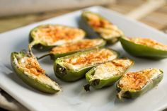 Four Cheese Jalapeno Poppers. Jalapeno poppers stuffed with a mixture of four different cheeses for a decadent and delicious party favor or appetizer. Healthy Snacks, Healthy Eating, Healthy Recipes, Delicious Recipes, Healthy Appetizers, Jalapeno Poppers, Stuffed Jalapeno Peppers, Baked Peppers, I Love Food