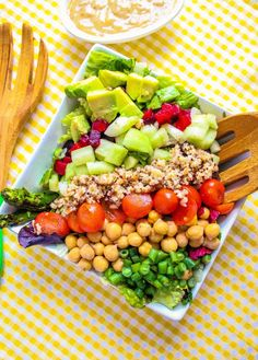 vegan cobb salad, with lettuce, asparagus, beans, beets, avocado, cucumber, tomatoes, garbanzo beans and quinoa