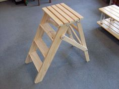 Picture of Folding Wooden Stepladder...This could be adapted to make a nice stool for shop or home.