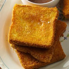 "Cornflake-Coated Baked French Toast Recipe -We fed a group of hungry Air Force cadets ""breakfast for dinner"" with this go-to baked French toast, along with eggs, sausage, bacon and fresh fruit. —Lois Enger, Colorado Springs, CO"