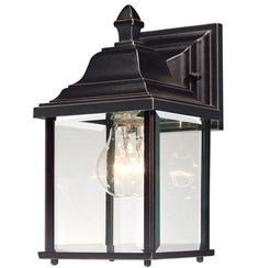 After picking out the perfect paint colors and choosing charming accents to deck out your abode, don't let your carefully curated style stop at your front door. Mount this one-light wall lantern on the porch to extend the warmth of your home to your outdoor space. Crafted with a beveled glass shade and metal fixture, this design brings classic appeal as it brightens your backyard. Pair this piece with an understated patio set to start off a cozy arrangement, then add a distressed bench fo...