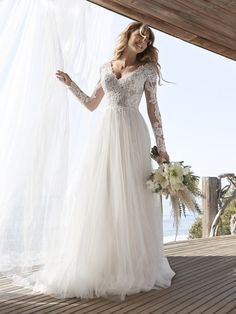 25558 -  Iris by Rebecca Ingram is all things romantic! Try this beauty on at Aurora Bridal in Melbourne, FL 321-254-3880