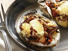 These dressed-up oysters provide a bed for garlic aioli with a wild mushroom and hickory-smoked bacon ragout.