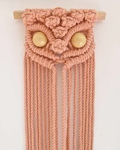 Mid way through knotting this peachy keen macrame owl by Tamara Maynes