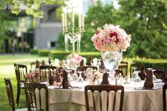 Two different centerpieces for tables. One with the candle/crystals and smaller vases w/ flowers. One large round/oval vase with flowers and pearls.