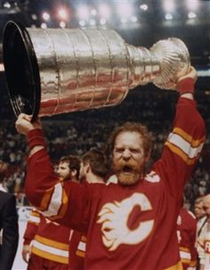 Calgary Flames' Lanny McDonald raises the Stanley Cup in Montreal Thursday, May 1989 after the Flames defeated the Canadians. Flames Hockey, Ice Hockey, Calgary, Lanny Mcdonald, Hockey Pictures, Hockey Teams, Hockey Stuff, Sports Memes, National Hockey League