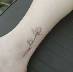 Minimalistic Ankle Tattoo Design with Delicate Tulips. 30+ Beautiful Flower Tattoo Designs.