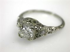 Edwardian engagement ring with a filigree setting