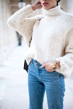 White handmade pullover, and blue jeans.