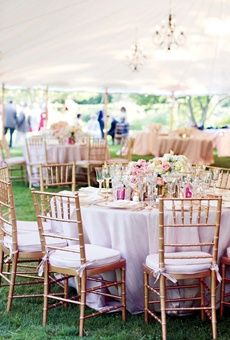 Pink and gold wedding reception with centerpeices of peonies, roses, and