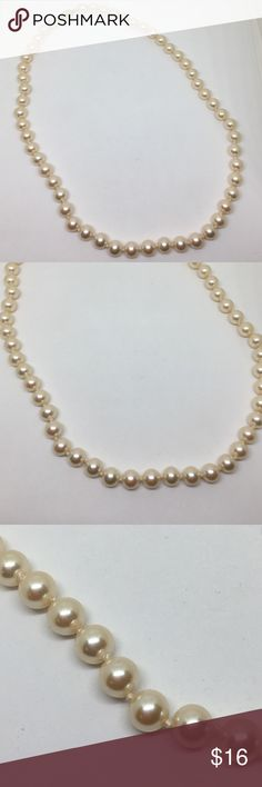 """Vintage Cream Glass Pearl Necklace A 20"""" necklace of creamy glass pearls, individuality knotted. A bright gold clasp holds the strand together. In excellent vintage condition, no flaws are seen at all. Every girl should own at least one strand of pearls! Vintage Jewelry Necklaces"""