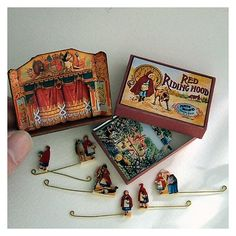 Miniature Theater of Red Riding Hood with mini theater and a special box to store all the scenery and characters when not in use. Stage is 2 inches and the arch stands just over 1 1/4 inches tall - from Open House Miniatures at http://openhouseminiatures.wordpress.com/2012/02/25/miniature-wooden-theatre-red-riding-hood/