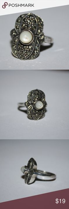 Mother of pearl and marcasite .925 ring size 6.5 sterling silver .925 stamped ring. Beautiful marcasites surrounding a white mother of pearl. Buy from me with confidence! I have sold over 400 items with a 5 star rating! If you have any questions, do not hesitate to ask.  Looking at a few things in my shop? Put a bundle together, comment on an item that you are ready to check out and let me send you an even better offer!  Thank you for visiting :) Free gifts with every purchase! Jewelry Rings