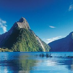 Visit beautiful Milford Track – New Zealand's most famous hiking trail.Experience 53 kilmoteres of lakes, suspension bridges and mountain peaks as you walk Milford Track. Milford Track, Hiking Trails, New Zealand, Tourism, Mountains, World, Travel Ideas, Places, Traveling