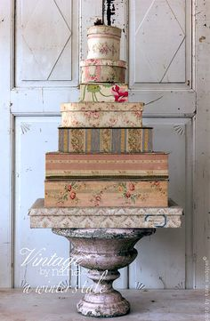 Vintage - cover odd boxes with beautiful vintage paper and stack on urn/flowerpot