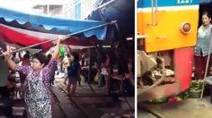Touristen filmen einen asiaitischen Martkplatz, als plötzlich dieses Teil einfach durchfährt