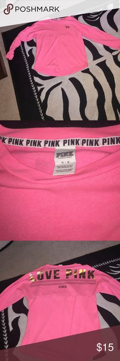 Pink top. Almost new pink top. Only worn once. Size medium. Pink and gold. Fuzzy on the inside. PINK Victoria's Secret Tops