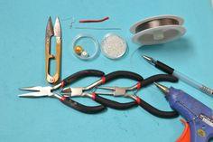 Supplies in the snowman earrings DIY: