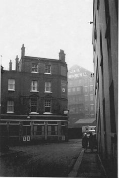 This 60's photo shows the Oxford Arms viewed from Church Street heading South to Deptford Broadway. The old Robinson Flour Mill can be seen in the background.The old Tide mills were replaced by Robinson's steam powered flour mill in the 1820s which was finally demolished after a fire in the 1970s.