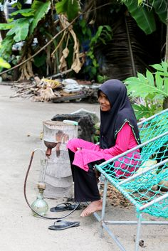 Woman with handcrafted shisha  #smoking #Maldives