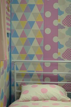 Love the pastel and geometric wallpapers from Graham & Brown. Perfect for a child's bedroom. Click through to take a tour.