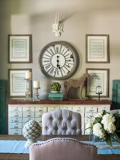 Small Room Design....I LOVE the old card catalog, the horse statue and the clock